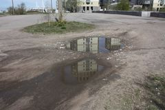 reflection homes in a puddle of court stock photo