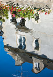 REflection of house decorated with geranium Stock Images
