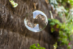 Reflection of a house in a sopa bubble in the air. Reflection of a house in a sopa bubble blowing in the air Stock Images