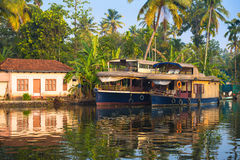 Reflection houseboat and house in kerala backwaters Royalty Free Stock Photography