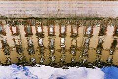 Reflection of houses of the city of St. Petersburg in the canals of the river. A natural phenomenon stock images