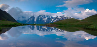 The reflection of the huge mountains in the lake Royalty Free Stock Image