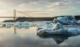 Reflection of ice cubes and hanging bridge at  Jokulsarlon Glacier Lagoon Royalty Free Stock Photo