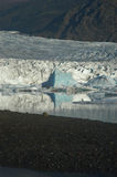 Reflection of Iceberg with Glacier in the Background. A Glacier Lake in Iceland royalty free stock photos
