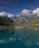Reflection of Jade Dragon Snow Mountain. At Baishui (White River), Lijiang, Yunnan, China stock photography