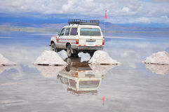 Reflection of jeep in flooded Salar de Uyuni Royalty Free Stock Photos