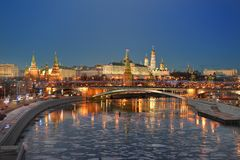 The reflection of the Kremlin in the Moscow river. Moscow at night in the winter. The reflection of the Kremlin in the Moscow river, Old stone bridge Royalty Free Stock Photo