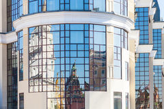 Reflection of Kremlin towers in modern building Stock Photography