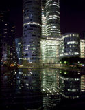 Reflection of La Defense Office buildings at night Stock Images