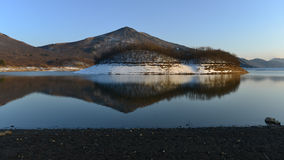 Reflection on the lake. There snow island are reflected on the lake Royalty Free Stock Photography