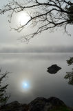 Reflection on lake Bohinj in early and foggy morning Royalty Free Stock Image