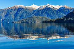 Reflection in Lake Hauroko, New Zealand. Reflection of snowy mountains in Lake Hauroko in the Southern Scenic Route, New Zealand royalty free stock photo