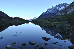 Reflection in lake while hiking to glacier grey. Royalty Free Stock Photos