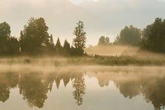 Reflection of lake Matheson early morning. New Zealand natural landscape Royalty Free Stock Image
