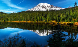 Reflection lake, Mt. Rainier. Reflection of an aircraft contrail on an early autum morning at Reflection Lake, Mt. Rainier Stock Photography