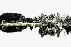 Reflection on lake in nearly black and white. stock image
