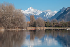 Reflection in the lake. This is a picture of the Bietschhorn (3934 m) in the canton of Valais and its reflection on this alpine lake near Sion Stock Photos