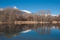 Reflection in the lake. This is a picture of the Mont Gond (2710 m) in the canton of Valais and its reflection on this alpine lake near Sion Stock Photo