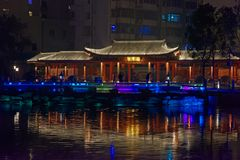 Reflection of the lake-Ruzi Pavilion Park night. Kiosks in the city of Nanchang province Xihu District in Jiangxi, West Lake, named for the memorial of the Stock Image