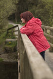 Reflection on life. A lone woman standing deep in thought Royalty Free Stock Photos