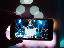 Reflection of light effects on  mobile phone at a concert (Gadge. Ts, new device, updates - concept Stock Image