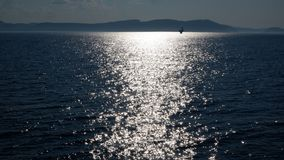 Reflection of light on the St. Lawrence River Canada. Reflection of light on the St. Lawrence River in the Quebec region, Canada. With views to the horizon of a royalty free stock images