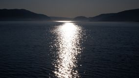 Reflection of light on the St. Lawrence River Canada. Reflection of light on the St. Lawrence River and Saguenay Fjord in the Quebec region, Canada region. With stock photography