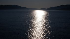 Reflection of light on the St. Lawrence River Canada. Reflection of light on the St. Lawrence River and Saguenay Fjord in the Quebec region, Canada region. With stock image
