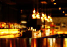 Reflection light on table with blur bar at night Royalty Free Stock Image