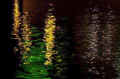 Reflection of lights on the water stock photo