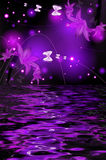 Reflection of a lily with butterflies Royalty Free Stock Photos