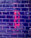 Reflection of the London phone booth in tile mosaic royalty free stock photo