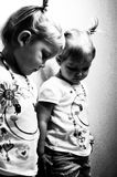 Reflection. Looks like twins -- Black and White Photo of a Child's Reflection in a Mirror Royalty Free Stock Photos
