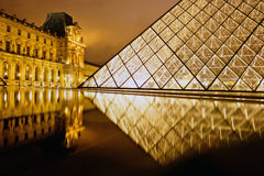 Reflection of the louvre palais Stock Photo