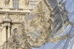Reflection of the Louvre pyramid Stock Photo
