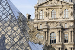 Reflection of the Louvre pyramid Stock Images