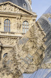 Reflection of the Louvre pyramid Stock Photography