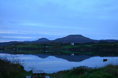Reflection of MacLeod's Tables. Pretty Dunvegan Loch at dusk in Scotland Stock Images