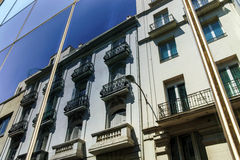 Reflection of Madrid street in modern building wall Stock Image