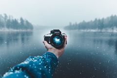 Reflection of Man Photographing in Snow Royalty Free Stock Images