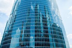 Reflection. Of many skyscrapers on a glass curved surface of another building. Modern downtown architecture Royalty Free Stock Images