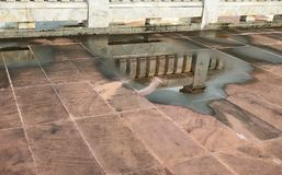 Reflection of Marble Wall in Water Logged Royalty Free Stock Photo