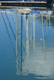 Reflection of masts Royalty Free Stock Images