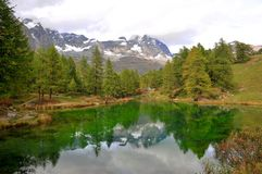 Reflection of Matterhorn at Lake Blue in Breuil-Cervinia, Italy Royalty Free Stock Photos