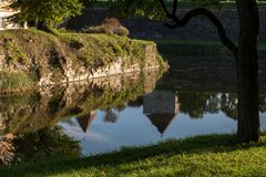 Reflection of MEDIEVAL castle in the moat royalty free stock photos