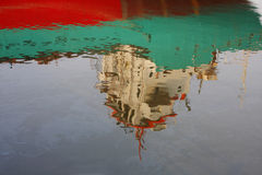 Reflection of merchantman and oil slick, Thailand. Royalty Free Stock Photos