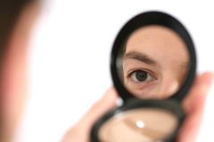 Reflection in a mirror. Applying makeup - reflection in a mirror Royalty Free Stock Photo