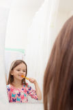 The reflection in the mirror baby teeth royalty free stock photography