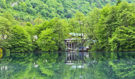 Reflection in the mirror of the Blue lake. Stock Photo