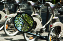 Reflection in mirror and bycicles Stock Photo